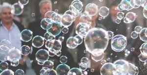 People standing behind bubbles. Clarity for Single Ingredient Groceries