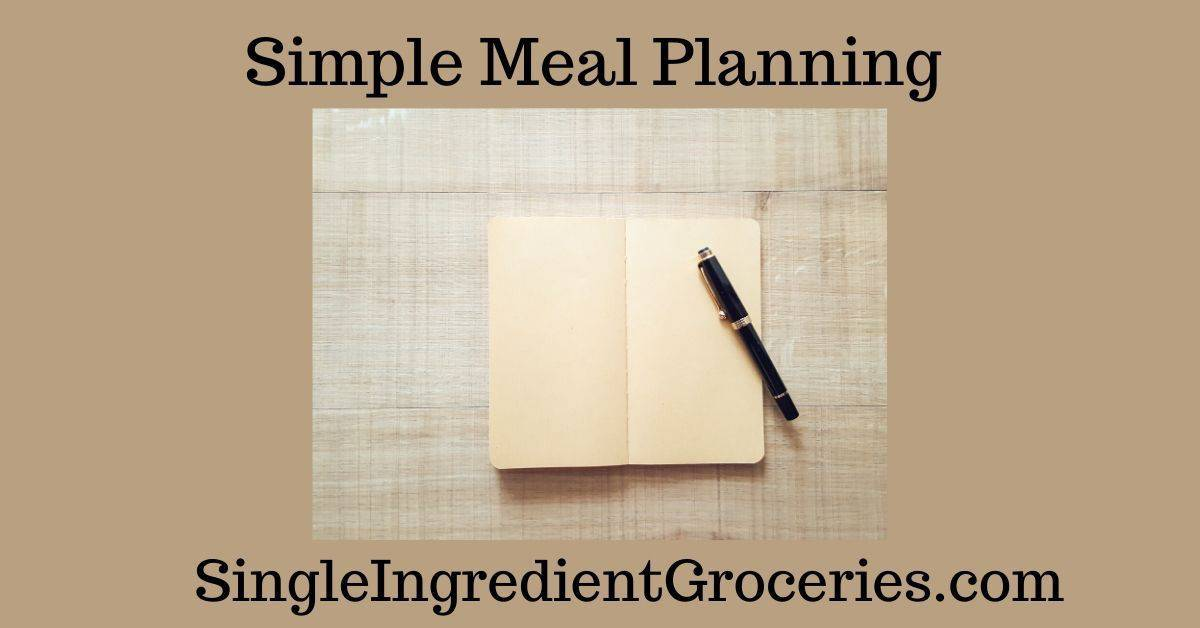 "BLOG POST IMAGE FOR SINGLE INGREDIENT GROCERIES TITLED ""SIMPLE MEAL PLANNING"" WITH IMAGE OF BEIGE NOTEBOOK WITH BLACK PEN ON NEUTRAL BACKGROUND"