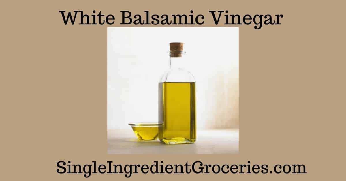 "BLOG IMAGE TITLED ""WHITE BALSAMIC VINEGAR"" FOR SINGLE INGREDIENT GROCERIES WITH IMAGE OF YELLOW LIQUID IN A CLEAR TALL BOTTLE WITH SMALL BOWL OF SAME LIQUID"